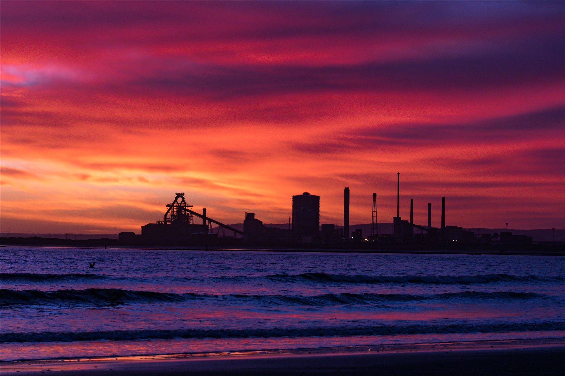 SSI Redcar Steel Works Sunrise, Red sky in the Morning - Taken on the 2/01/18 on a very cold Seaton Beach looking over the river to SSI Redcar Steel Works by AJ Stoves Photography