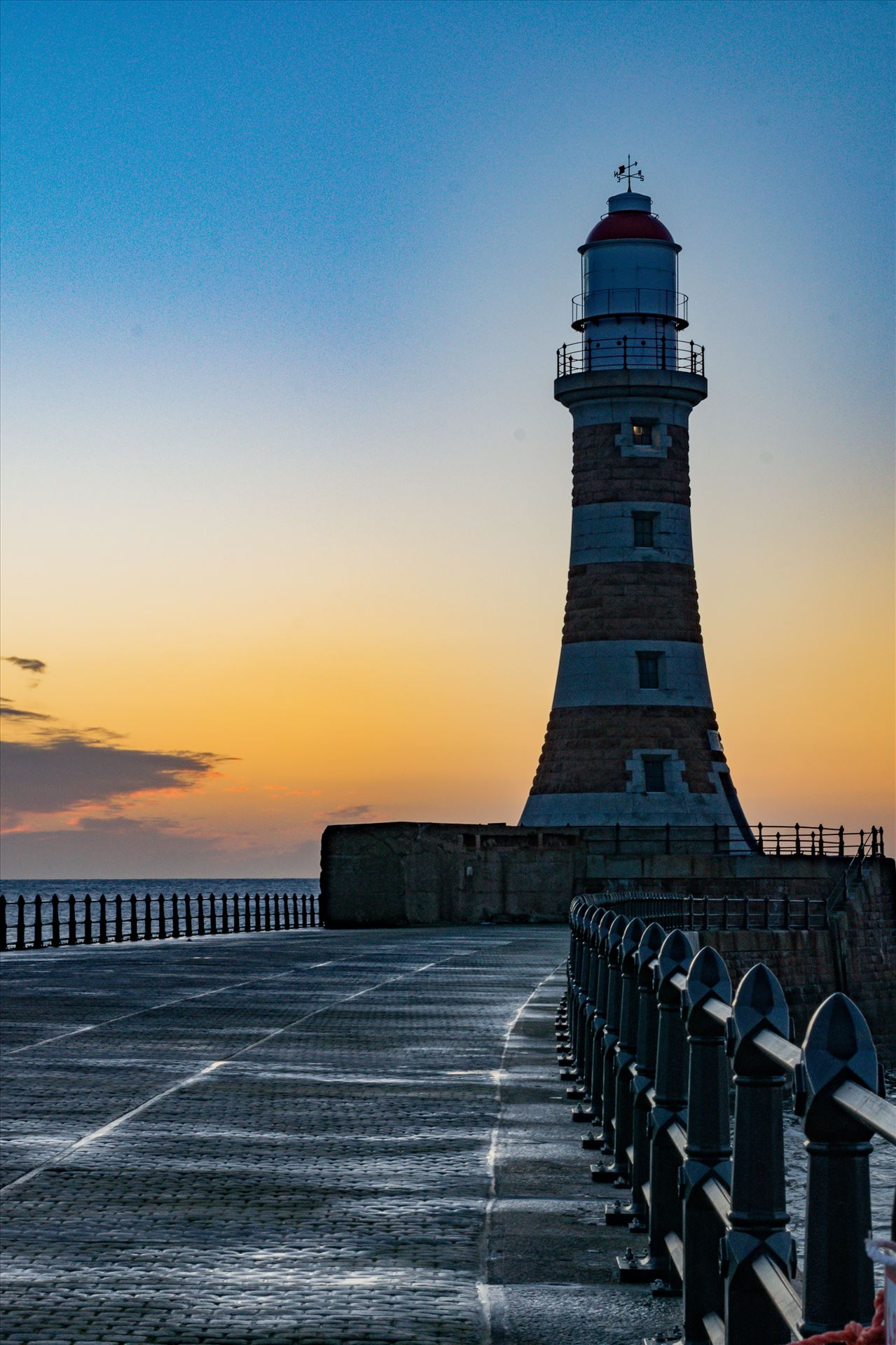 Roker Sunrise Lighthouse, at first light - Roker at sunrise by AJ Stoves Photography