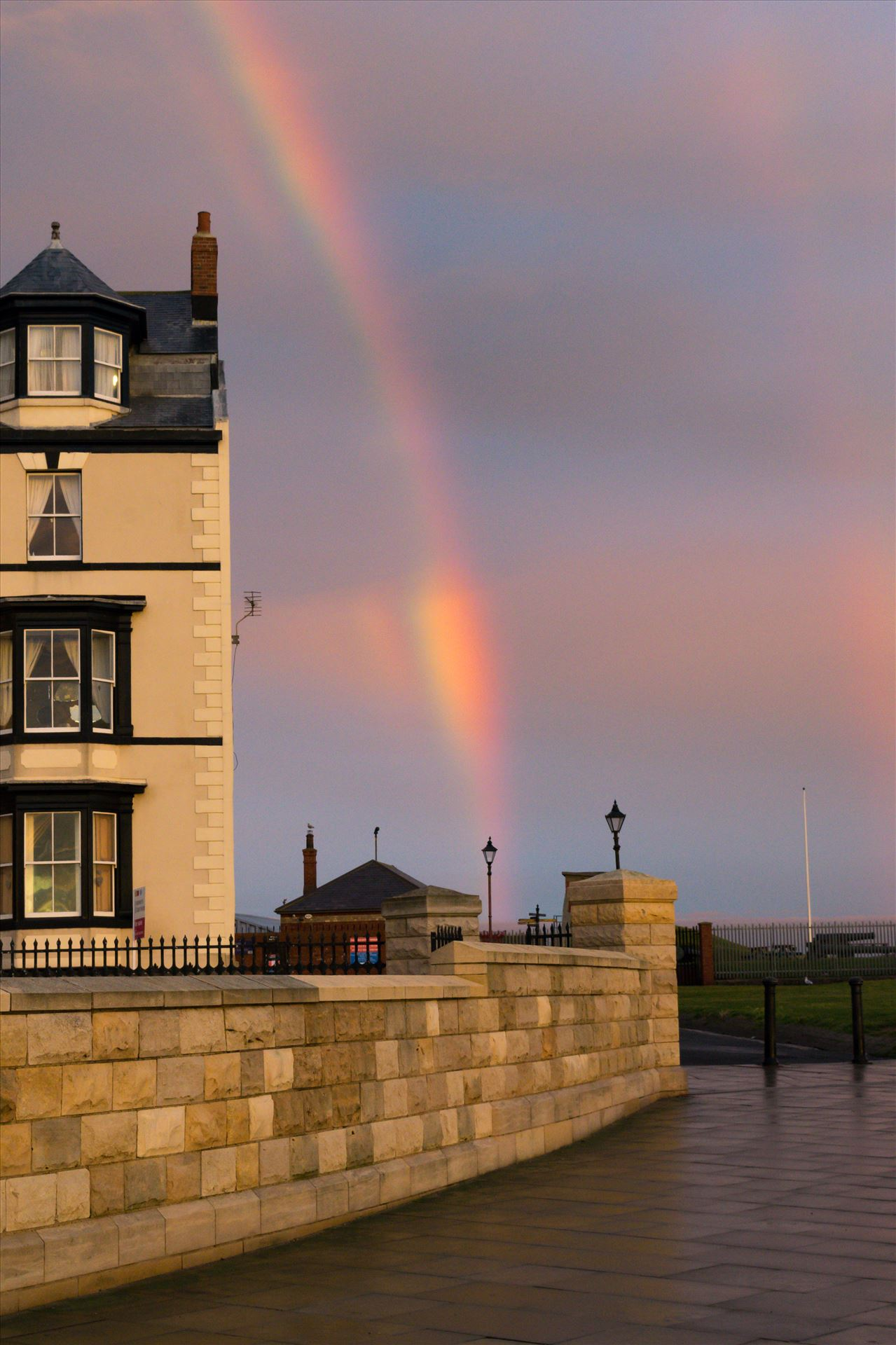 Rainbow at Sunrise - A rainbow at first light at Hartlepool Headland by AJ Stoves Photography
