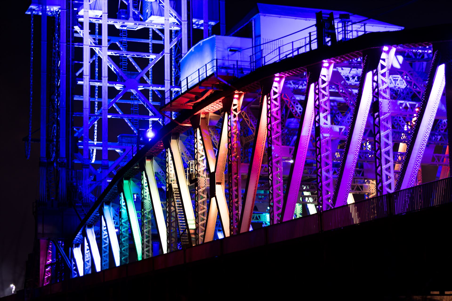 Newport Bridge Rainbow Lights Close up - Newport Bridge in all its Colourful Glory by AJ Stoves Photography